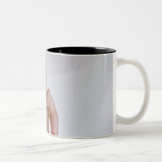 Woman holding hand up with outstretched small Two-Tone mug
