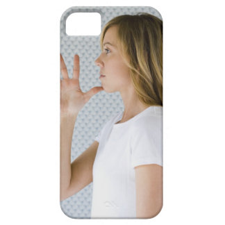 Woman holding open hand to chin. iPhone 5 cases