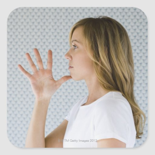Woman holding open hand to chin. sticker
