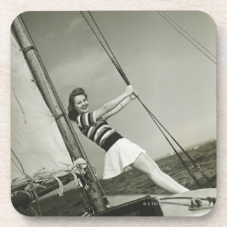 Woman Holding Rigging on Yacht Drink Coasters