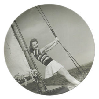 Woman Holding Rigging on Yacht Plate