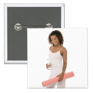 Woman holding water bottle and exercise mat 15 cm square badge
