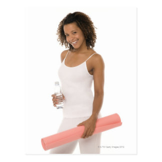 Woman holding water bottle and exercise mat postcard