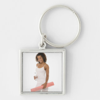 Woman holding water bottle and exercise mat Silver-Colored square key ring