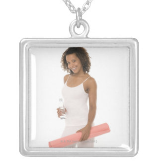 Woman holding water bottle and exercise mat square pendant necklace