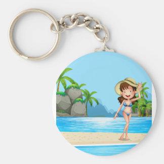 Woman in bikini on the beach basic round button key ring