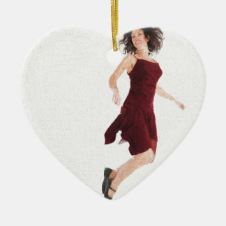 Woman in red jumping ceramic heart decoration