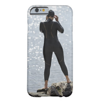Woman in wetsuit standing on rock barely there iPhone 6 case