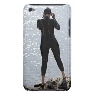 Woman in wetsuit standing on rock barely there iPod case