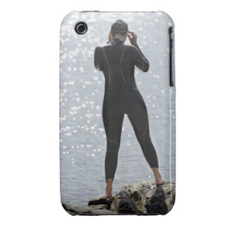 Woman in wetsuit standing on rock iPhone 3 cover