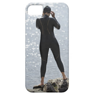 Woman in wetsuit standing on rock iPhone 5 covers