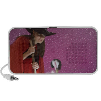 Woman in witch costume stirring cauldron iPhone speakers