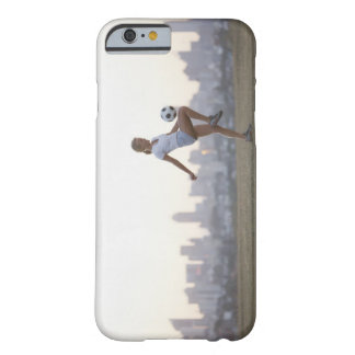 Woman kneeing soccer ball in urban park barely there iPhone 6 case