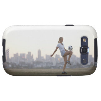 Woman kneeing soccer ball in urban park samsung galaxy s3 covers