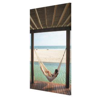 Woman Laying On A Hammock At A Small Hotel Gallery Wrapped Canvas