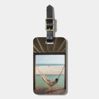 Woman Laying On A Hammock At A Small Hotel Luggage Tag