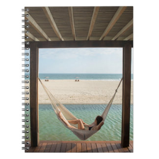 Woman Laying On A Hammock At A Small Hotel Notebook