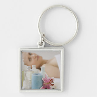 Woman laying on spa table key ring
