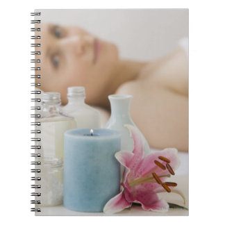 Woman laying on spa table notebooks