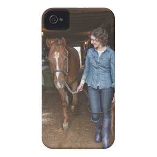 Woman leading horse iPhone 4 case