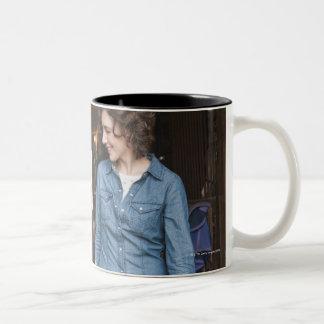 Woman leading horse Two-Tone coffee mug