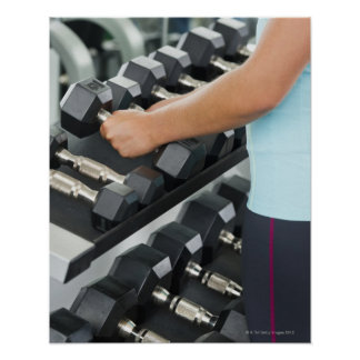 Woman lifting dumbbells 2 poster
