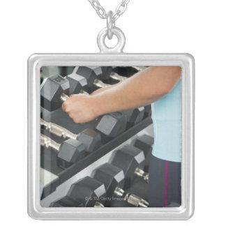 Woman lifting dumbbells 2 square pendant necklace