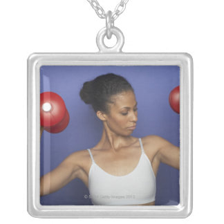 Woman lifting dumbbells 3 silver plated necklace
