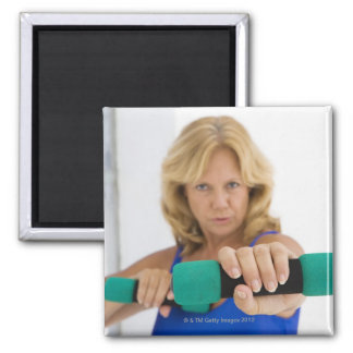 Woman lifting dumbbells magnet