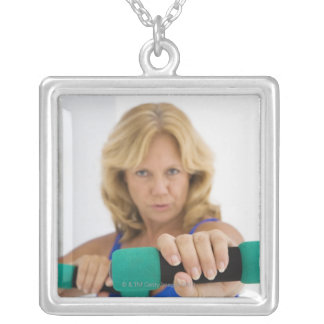 Woman lifting dumbbells square pendant necklace