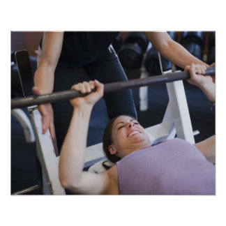 Woman lifting weights 2 posters