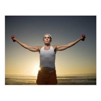 Woman lifting weights 4 post card