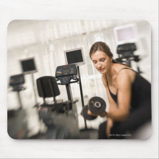 Woman lifting weights in gym 2 mouse mat