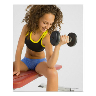 Woman lifting weights posters