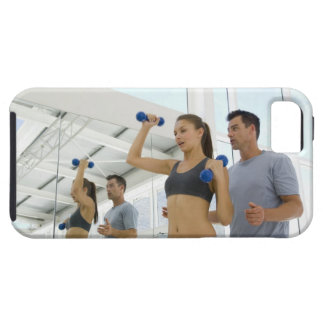 Woman lifting weights with trainer iPhone 5 cases