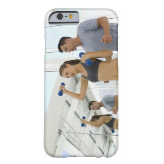 Woman lifting weights with trainer barely there iPhone 6 case