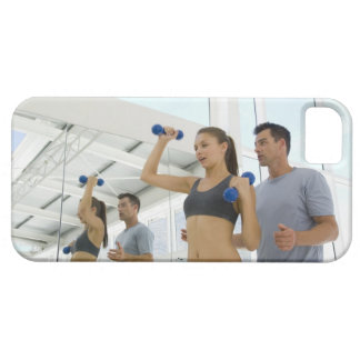 Woman lifting weights with trainer iPhone 5 case