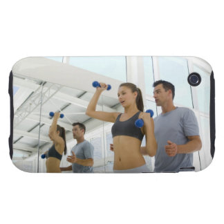 Woman lifting weights with trainer tough iPhone 3 cover