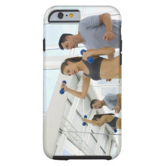 Woman lifting weights with trainer tough iPhone 6 case
