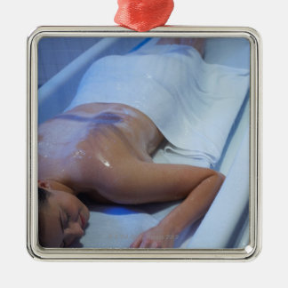 Woman lying down in vichy shower christmas ornament