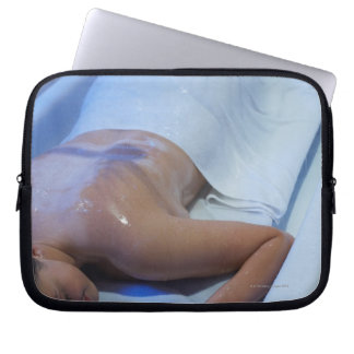 Woman lying down in vichy shower laptop sleeve