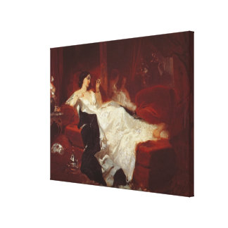 Woman on a red sofa canvas print