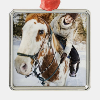 Woman on horse outdoors during winter christmas ornament
