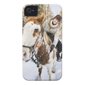 Woman on horse outdoors during winter iPhone 4 covers