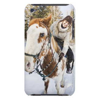 Woman on horse outdoors during winter iPod touch case
