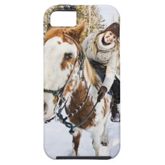 Woman on horse outdoors during winter tough iPhone 5 case