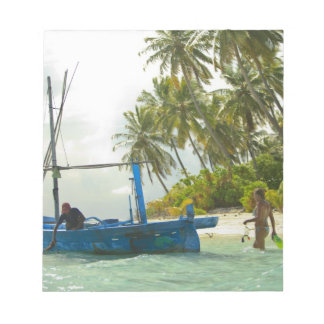 Woman on small traditional fishing boat, notepad