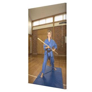 Woman performing Ken-Do-Kai Karate, smiling, Canvas Print
