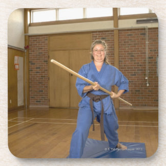 Woman performing Ken-Do-Kai Karate, smiling, Coaster