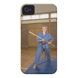 Woman performing Ken-Do-Kai Karate, smiling, iPhone 4 Cases